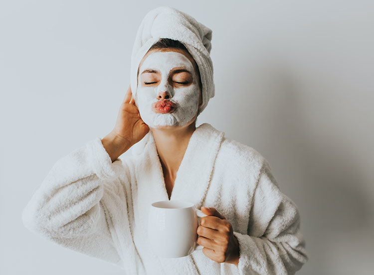 woman with a moisturizing face mask